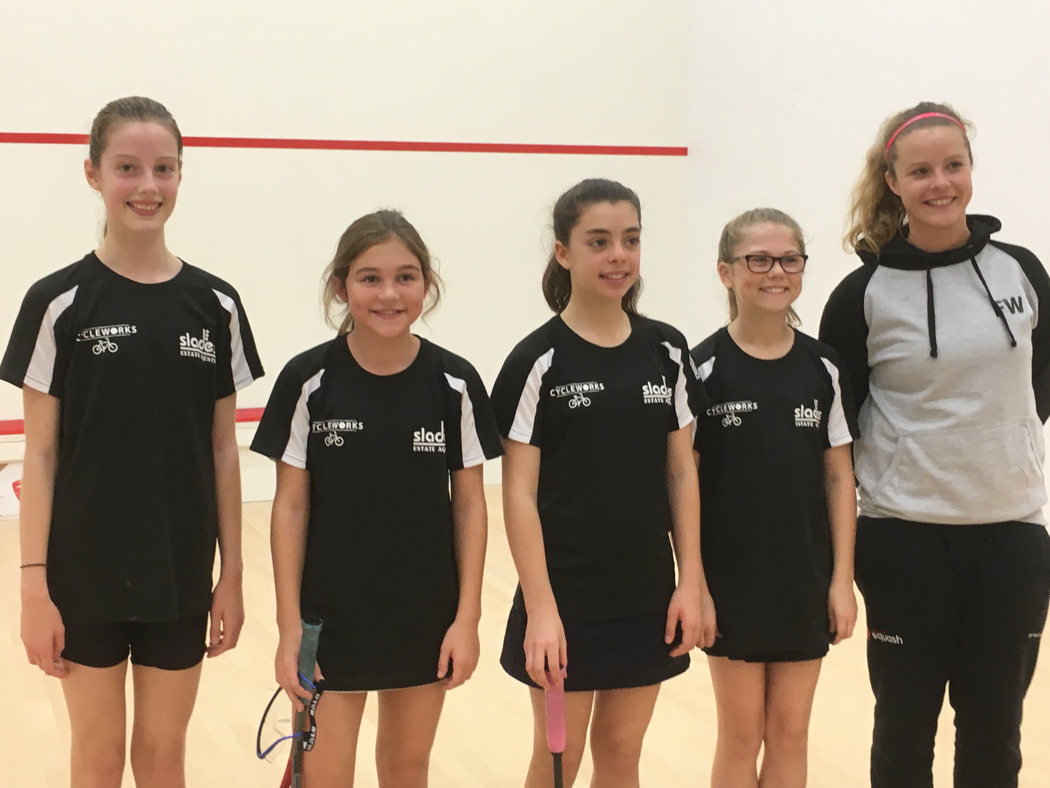 Girls U13 team and squash coach - Left to right; Nia Edwards, India McCrudden, Amy Campbell-Wynter, Abi Russell, Fran White